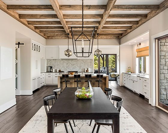 Rustic open space kitchen with island and a table for 6